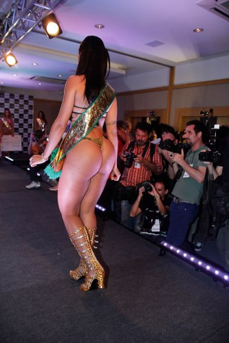 "Stunning brunette Dai Macedo, with her 42 inches of 'bumbum', officially has the best butt in the land famous for its derrieres after being crowned Miss Butt Brazil 2013 in one of the most controversial and hotly-contested editions of the competition to date. But she admitted that she had had help from liposuction. The 25-year-old, representing the central state of Goias, beat off competition from 14 other finalists at the event in Sao Paulo to walk away with the top prize which is set to include international fame, a GBP1,350 cash prize and advertising contracts worth ten times that. It came after some of the fiercely competitive candidates - including Ms Macedo - had thrown the pageant into disarray by claiming on twitter some of the girls had paid to guarantee a top three result. Eliana Amaral, who came in 2nd, was said to have paid for the result and also to have forged an x-ray to show she did not have a butt implant. Third place this year went to Jessica Amaral. ""I'm all emotional - I didn't expect to win,'' said Ms Macedo as she put the pre-event controversy behind her. ""All hell broke loose on social media sites but now I can say the contest was real.'' But she admitted she had a bit of help with her butt. ""It isn't 100 per cent natural - I had a butt lift. I always had a large backside but liposuction improved it."" Pictured: Dai Macedo Ref: SPL648758 141113 Picture by: Photo Rio News / Splash News Splash News and Pictures Los Angeles:310-821-2666 New York: 212-619-2666 London: 870-934-2666 photodesk@splashnews.com"